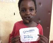 Doubara writes his name